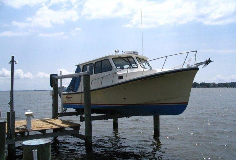 Boat in dry dock before bilge pump repairs